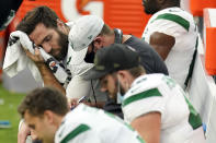 New York Jets quarterback Joe Flacco, top right, wipes sweat off his face during the second half of an NFL football game against the Los Angeles Chargers Sunday, Nov. 22, 2020, in Inglewood, Calif. (AP Photo/Jae C. Hong)