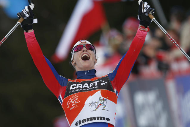 Norway's Marit Bjoergen celebrates at the end of a Tour de Ski, women's 9-kilometer cross-country ski event in Val di Fiemme, northern Italy, Sunday, Jan. 11, 2015. (AP Photo/Alessandro Trovati)