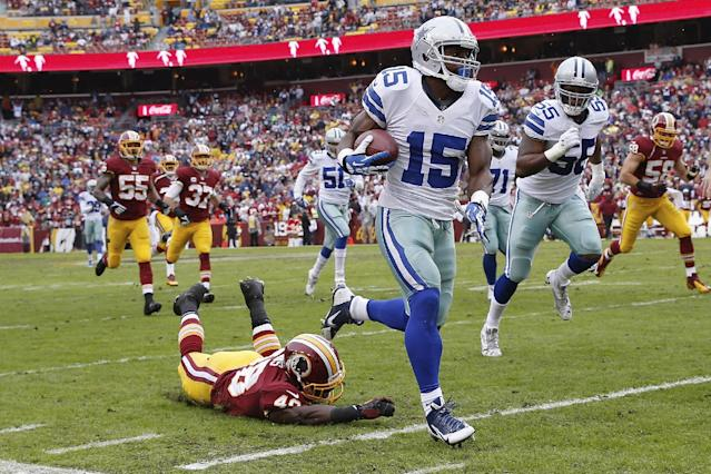 Dallas Cowboys wide receiver Micheal Spurlock (15) leaves Washington Redskins strong safety Jose Gumbs on the turf while returning a punt during the first half of an NFL football game in Landover, Md., Sunday, Dec. 22, 2013. (AP Photo/Alex Brandon)