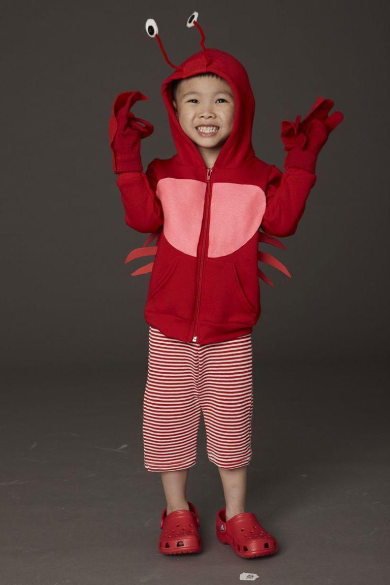 """<p>Bundle your little one up in a red sweatshirt with pipe cleaner antennae eyes and claw-shaped felt covered gloves for this crustacean costume that is cute, but warm!</p><p><em><strong><a href=""""https://www.womansday.com/home/crafts-projects/how-to/a5886/diy-halloween-costume-crab-123695/"""" rel=""""nofollow noopener"""" target=""""_blank"""" data-ylk=""""slk:Get the Crab tutorial"""" class=""""link rapid-noclick-resp"""">Get the Crab tutorial</a>.</strong></em></p>"""