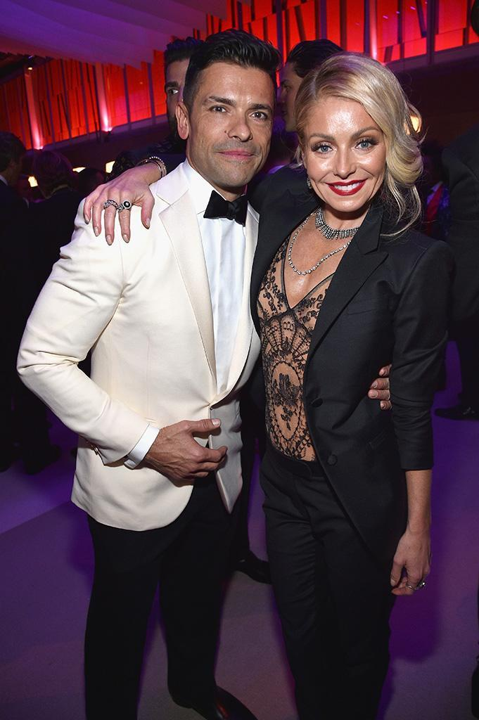 <p>Date night! The pair, who have been married for 20 years, kept in close contact at the Vanity Fair party, and rocked sharp hers and his suits. Hers was a little sexier though. Lil' bit. (Photo: Kevin Mazur/VF17/WireImage) </p>