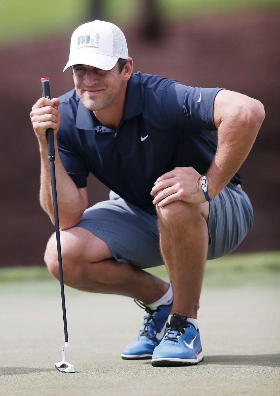 <p>Aaron Rodgers lines up a putt during Aria Resort & Casino's 13th Annual Michael Jordan Celebrity Invitational at Shadow Creek in April 2014.</p>