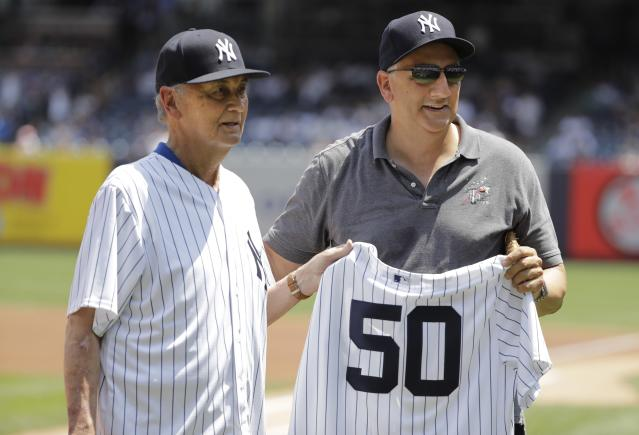 Astronaut Mike Massamino, right, poses for photographs with former New York Yankees pitcher Jack Aker before a baseball game between the New York Yankees and the Colorado Rockies Saturday, Jan. 20, 2019, in New York. (AP Photo/Frank Franklin II)