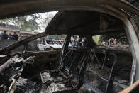 Burnt cars stand on a street that saw clashes Tuesday in New Delhi, India, Wednesday, Feb. 26, 2020. At least 20 people were killed in three days of clashes in New Delhi, with the death toll expected to rise as hospitals were overflowed with dozens of injured people, authorities said Wednesday. The clashes between Hindu mobs and Muslims protesting a contentious new citizenship law that fast-tracks naturalization for foreign-born religious minorities of all major faiths in South Asia except Islam escalated Tuesday. (AP Photo/Rajesh Kumar Singh)
