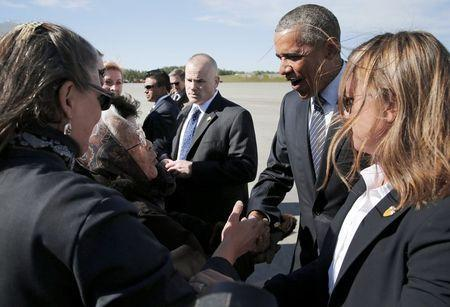 Author and founding member of the Fairbanks Native Association Poldine Carlo (L) greets U.S. President Barack Obama after he arrived aboard Air Force One at Elmendorf Air Force Base in Anchorage, Alaska August 31, 2015. REUTERS/Jonathan Ernst
