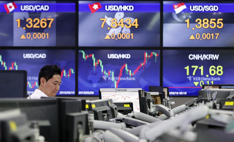 A currency trader watches monitors at the foreign exchange dealing room of the KEB Hana Bank headquarters in Seoul, South Korea, Monday, Aug. 19, 2019. Asian shares were higher Monday, as investors continue to rejigger their read on President Donald Trump's trade war and growing worries about slowing economies around the world.(AP Photo/Ahn Young-joon)