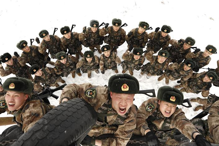 Frontier soldiers climb tyres wall in a drill on February 27, 2019 in Heihe, Heilongjiang Province of China.