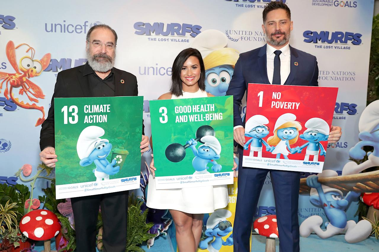 (From left) Mandy Patinkin, Demi Lovato, and Joe Manganiello visited theUnited Nations in New York Cityto celebrateInternational Day of Happiness in conjunction with Smurfs: The Lost Villageon Saturday.