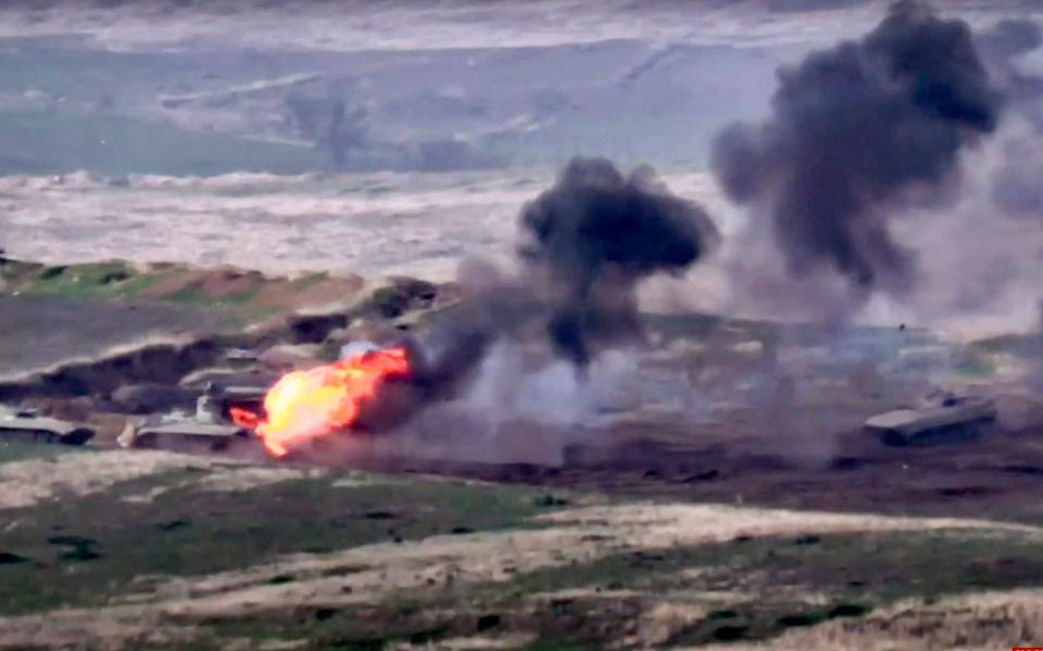 Footage released by the Armenian defence ministry showed an Azerbaijani military vehicle being destroyed - Armenian Defense Ministry via AP
