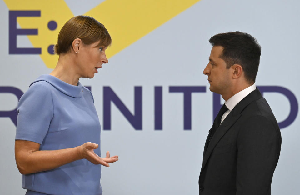 Ukrainian President Volodymyr Zelenskyy, right, and President of the Republic of Estonia, Kersti Kaljulaid talk during the Crimean Platform Summit in Kyiv, Ukraine, Monday, Aug. 23, 2021. The Crimea Platform is a new international consultation and coordination format to strengthen an international response to the ongoing Russia's occupation of Crimea. (Ukrainian Presidential Press Office via AP)