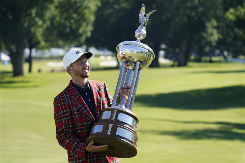 Daniel Berger poses with the trophy after winning the Charles Schwab Challenge in a playoff at Colonial Country Club in Fort Worth, Texas. (AP Photo/David J. Phillip)