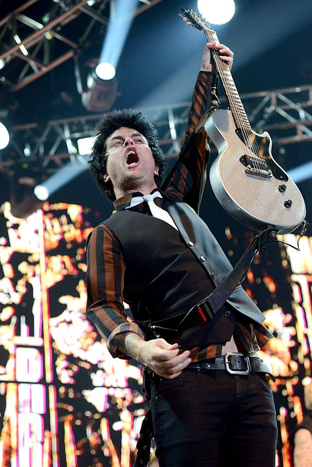 <p>Singer Billie Joe Armstrong of Green Day performs during KROQ's Almost Acoustic Christmas at the Forum on Dec.11, 2016, in Inglewood, Calif. (Photo: Scott Dudelson/WireImage) </p>