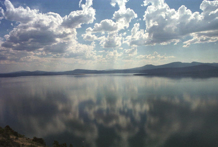 FILE - This Aug. 9, 2001 file photo shows Upper Klamath Lake near Klamath Falls, Ore. One of the worst droughts in memory in the massive agricultural region straddling the California-Oregon border could mean steep cuts to irrigation water for hundreds of farmers this summer to sustain endangered fish species critical to local tribes. The U.S. Bureau of Reclamation, which oversees water allocations in the federally owned Klamath Project, is expected to announce this week how the season's water will be divvied up after delaying the decision a month. (AP Photo/Jeff Barnard, File)