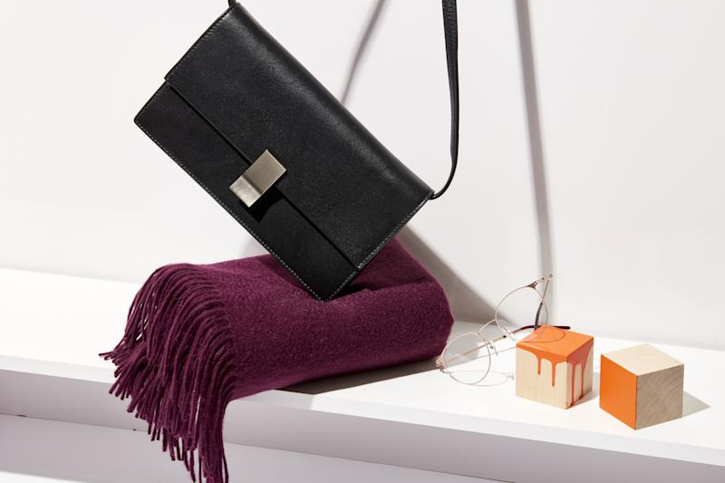 A clasp shoulder bag ($135), cashmere scarf ($95), and glasses ($75) from Italic