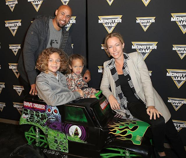 "<p>Kendra Wilkinson <a href=""https://uk.news.yahoo.com/kendra-wilkinson-baskett-admits-having-024647898.html"" data-ylk=""slk:opened up about marital trouble;outcm:mb_qualified_link;_E:mb_qualified_link"" class=""link rapid-noclick-resp"">opened up about marital trouble</a> last week, but things looked OK with Hank Baskett as the pair posed on a mini monster truck with their kids, Hank Jr. and camo lover Alijah. Though if you are having trouble getting along with someone, a monster truck event is a safe place to be because you can't hear each other over the noise. (Photo: Ari Perilstein/Getty Images for Feld Entertainment) </p>"