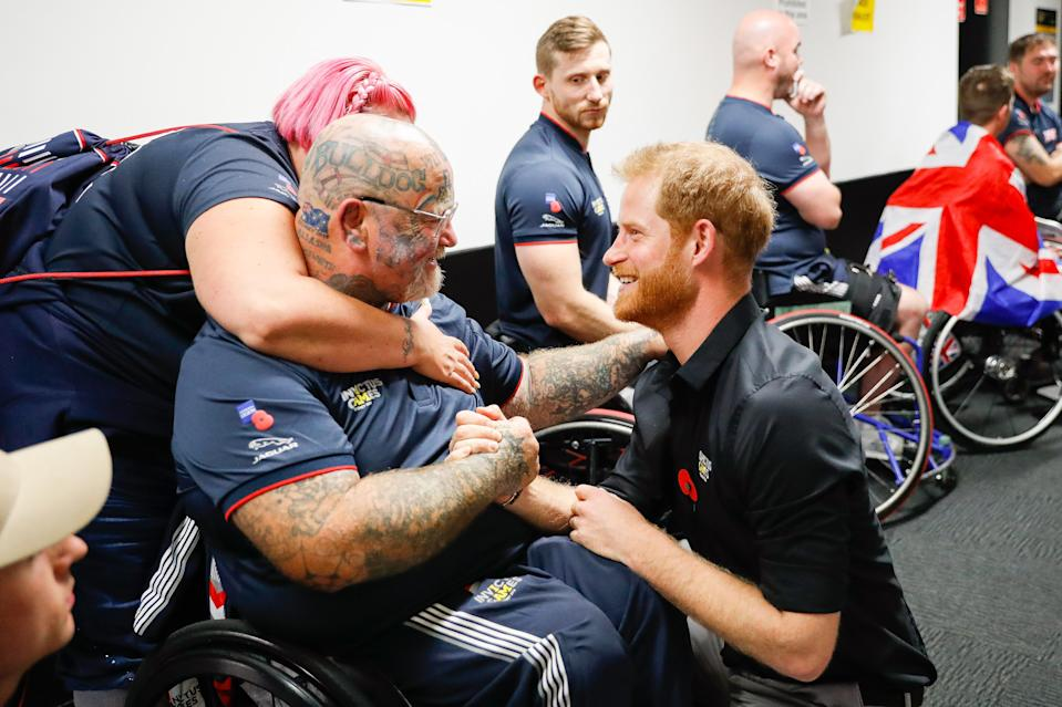 SYDNEY, AUSTRALIA - OCTOBER 27:  Prince Harry, Duke of SussexÊ congratulating Paul Guest aka 'Bear' at the Wheelchair Basketball after United States winning Gold in the finals during day eight of the Invictus Games Sydney 2018 at on October 27, 2018 in Sydney, Australia.  (Photo by Chris Jackson/Getty Images for the Invictus Games Foundation)