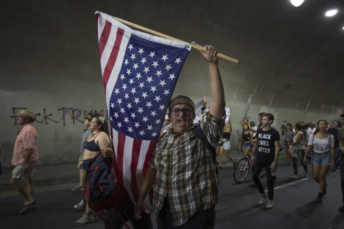 <p>Protesters pass through a tunnel as the march in reaction to the upset election of Republican Donald Trump over Democrat Hillary Clinton in the race for President of the United States on November 12, 2016 in Los Angeles. (David McNew/Getty Images) </p>