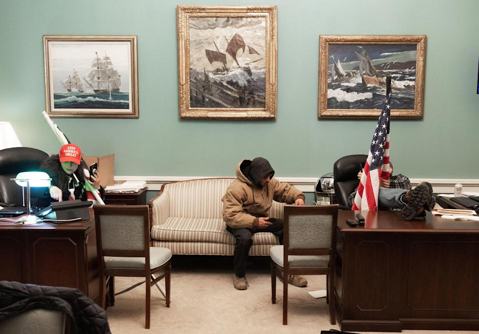 Rioters inside Nancy Pelosi's office at the Capitol, January 6, 2021.