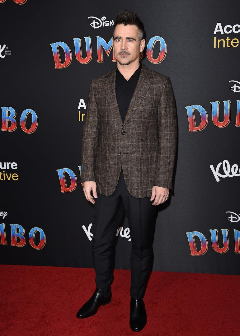 <p>Colin Farrell chose a tweed jacket and Chelsea boots for the starry photocall. <em>[Photo: Getty]</em> </p>