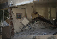 The interior of a destroyed living room of a family flat is seen after the building collapsed in Izmir, Turkey, Sunday, Nov. 1, 2020. Rescue teams continue ploughing through concrete blocs and debris of collapsed buildings in Turkey's third largest city in search of survivors of a powerful earthquake that struck Turkey's Aegean coast and north of the Greek island of Samos, Friday Oct. 30, killing dozens Hundreds of others were injured.(AP Photo/Emrah Gurel)