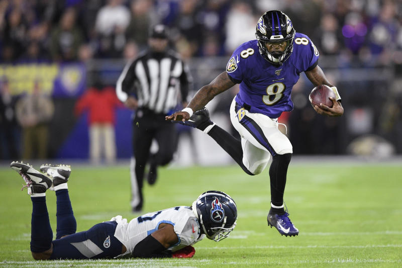 Baltimore Ravens quarterback Lamar Jackson (8) runs past Tennessee Titans cornerback Logan Ryan (26) during the second half an NFL divisional playoff football game, Saturday, Jan. 11, 2020, in Baltimore. (AP Photo/Nick Wass)