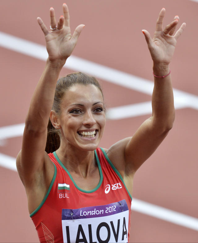 Bulgaria's Ivet Lalova gestures to spectators after competing in a women's 100-meter heat during the athletics in the Olympic Stadium at the 2012 Summer Olympics, London, Friday, Aug. 3, 2012. (AP Photo/Martin Meissner)