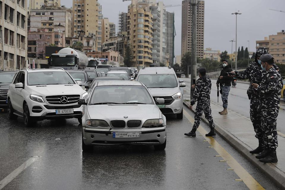 Policemen control cars at a checkpoint on the Fuad Shahab bridge known as the 'Ring' in BeirutAFP/Getty