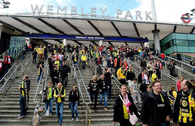 Fans make their way from Wembley Park Station near Wembley Stadium before the game.