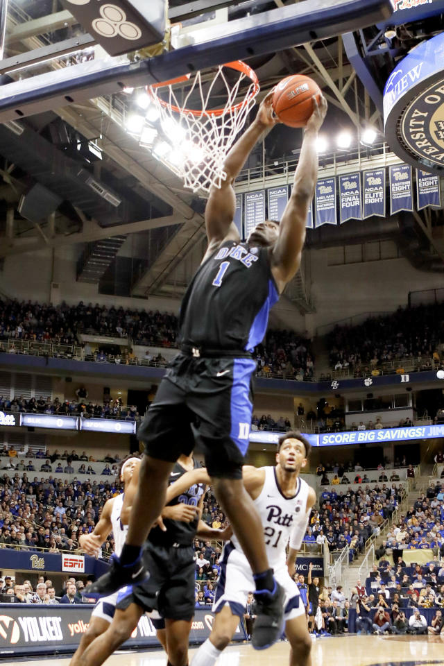 Duke's Zion Williamson (1) goes up for during a dunk in front of Pittsburgh's Terrell Brown (21) during the first half of an NCAA college basketball game, Tuesday, Jan. 22, 2019, in Pittsburgh. (AP Photo/Keith Srakocic)