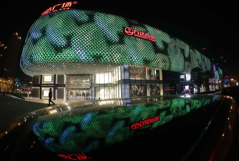 File photo of a man walking in front of an entrance to a Wanda Department Store in Wuhan
