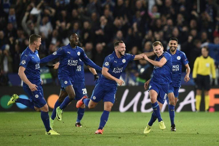 Leicester City's midfielder Marc Albrighton (2R) celebrates scoring their second goal with teammates Danny Drinkwater (3R) and Riyad Mahrez (R) during the UEFA Champions League round of 16 second leg football match against Sevilla on March 14, 2017