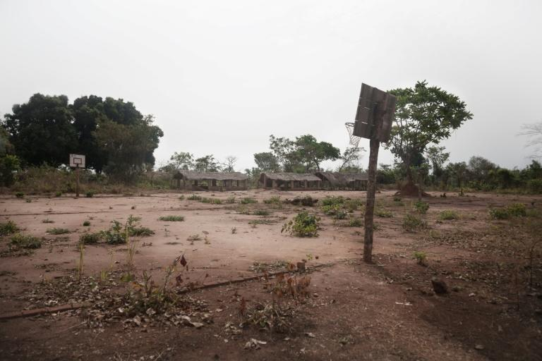 An abandoned school and a stadium in the South Sudanese refugee camp in Obo