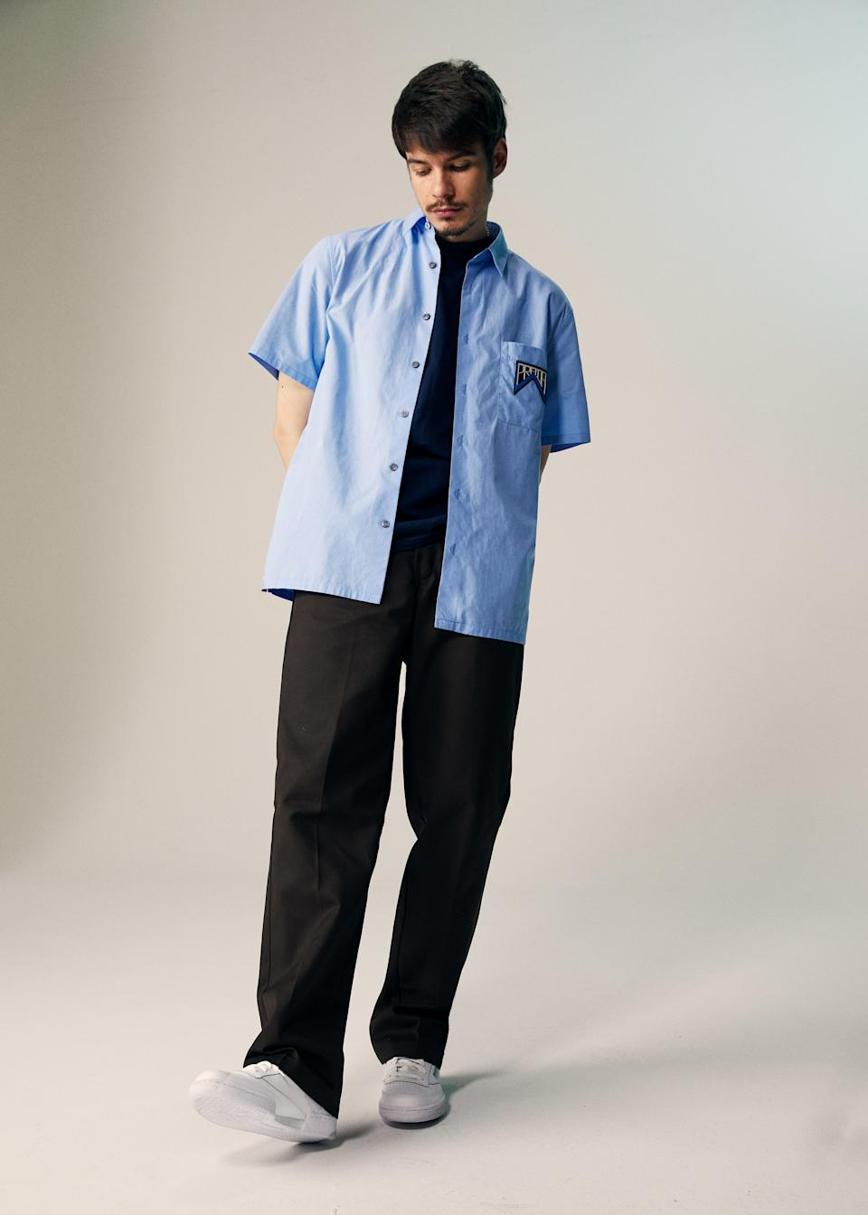 """<cite class=""""credit"""">Tee by Ben Davis / Shirt by Prada / Pants by Dickies / Shoes by Reebok</cite>"""