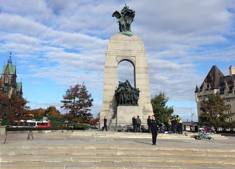 Police guard the scene of a shooting at the National War Memorial in Ottawa, Canada