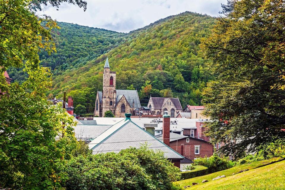 <p>Nestling a town right in the middle of hills just instantly makes it seem more cozy, and Jim Thorpe, Pennsylvania, is no exception. Stunning year-round with a nearby river, train, and bike path, this village is filled with shops, nice people, and fantastic foliage in the fall. </p>