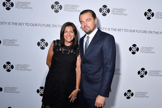 <p>DiCaprio got support from Paris's first female mayor, who was presented with the foundation's New World Leadership Award. (Photo by Victor Boyko/Getty Images for LDC Foundation) </p>