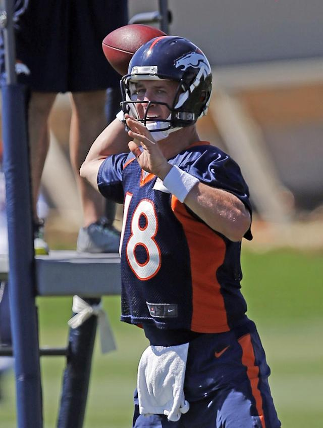 Denver Broncos quarterback Peyton Manning throws during a joint practice between the Broncos and the Houston Texans on Tuesday, Aug. 19, 2014, in Englewood, Colo. (AP Photo/Jack Dempsey)