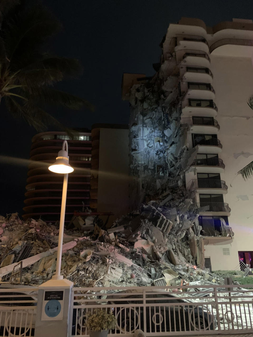 A high-rise residential building is partially collapsed in Surfside, Fla., Thursday, June 24, 2021. A large rescue effort is underway at the scene. (Miami Beach Police via The New York Times)