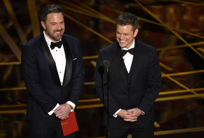 """FILE - Ben Affleck, left, and Matt Damon present the award for best original screenplay at the Oscars on Feb. 26, 2017, at the Dolby Theatre in Los Angeles. The Venice Film Festival has unveiled a starry lineup of world premieres for its 78th edition kicking off on Sept. 1, 2021, including Ridley Scott's medieval drama """"The Last Duel,"""" featuring Damon, Affleck and Adam Driver. (Photo by Chris Pizzello/Invision/AP, File)"""