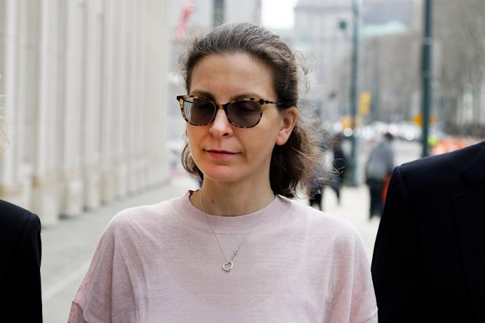 Clare Bronfman, a member of NXIVM, arrives at Brooklyn Federal Court, in New York on April 8, 2019. | Mark Lennihan—AP/Shutterstock