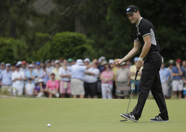 Martin Kaymer, of Germany, reacts after missing a putt on the ninth hole during the second round of the U.S. Open golf tournament in Pinehurst, N.C., Friday, June 13, 2014. (AP Photo/Chuck Burton)