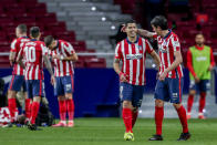 Atletico Madrid's Luis Suarez, second right, celebrates with his teammate Stefan Savic after scoring his side's first goal during the Spanish La Liga soccer match between Atletico Madrid and Alaves at the Wanda Metropolitano stadium in Madrid, Spain, Sunday, March 21, 2021. (AP Photo/Manu Fernandez)