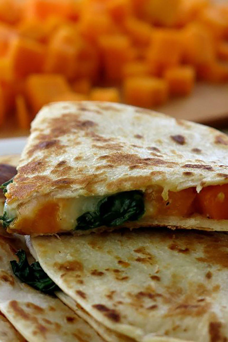 """<p>Sneak some extra veggies into quesadillas that offer a fall twist on a Mexican classic.</p><p><strong>Get the recipe at <a href=""""http://www.dinner-mom.com/butternut-squash-and-spinach-quesadillas/"""" rel=""""nofollow noopener"""" target=""""_blank"""" data-ylk=""""slk:The Dinner Mom"""" class=""""link rapid-noclick-resp"""">The Dinner Mom</a>.</strong><br></p>"""