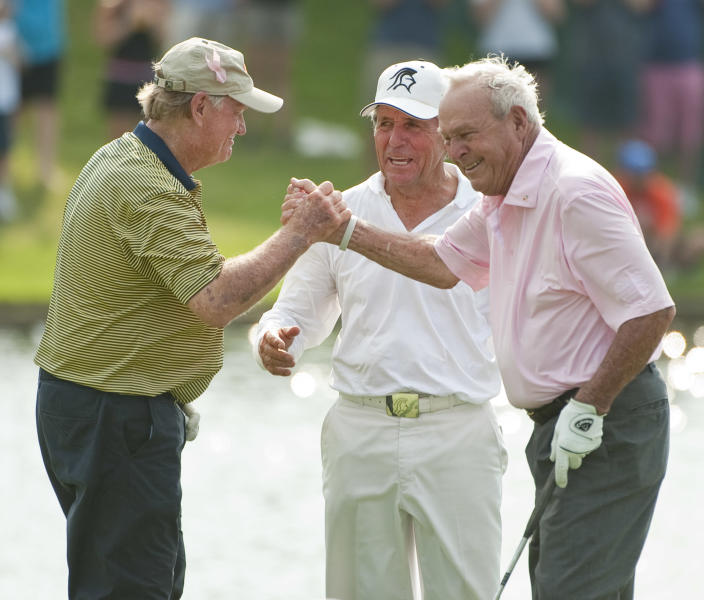 Jack Nicklaus, left, Gary Player, center, and Arnold Palmer, right, react after Palmer's birdie putt on the 18th green during a Greats of Golf event Saturday, May 5, 2012, in The Woodlands, Texas. (AP Photo/Dave Einsel)