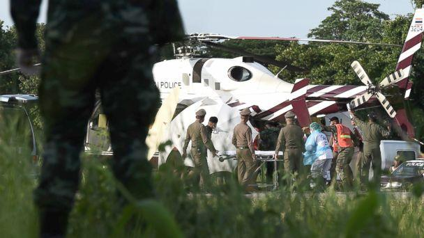PHOTO: Rescue workers bring a stretcher close to a police helicopter at a military airport in Chiang Rai on July 9, 2018, as rescue operations continue for those still trapped inside the cave in Khun Nam Nang Non Forest Park in the Mae Sai district. (Lillian Suwanrumpha/AFP/Getty Images)