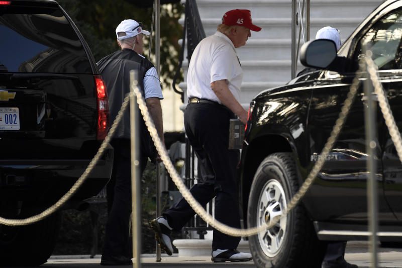 President Donald Trump gets out of his car as he was returning to the White House in Washington, Saturday, Sept. 28, 2019, after spending the day playing golf. (AP Photo/Susan Walsh)