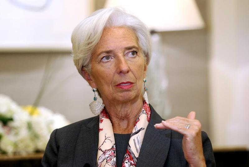IMF Managing Director Christine Lagarde gestures during an interview with Reuters in Dubai