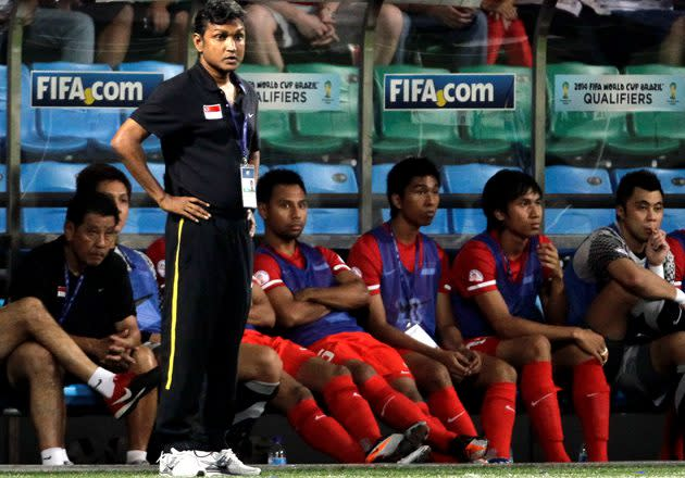 Singapore's assistant coach V Sundramoorthy watches as his team plays against Jordan during their 2014 FIFA World Cup qualifying soccer match in Singapore October 11, 2011. REUTERSTim Chong