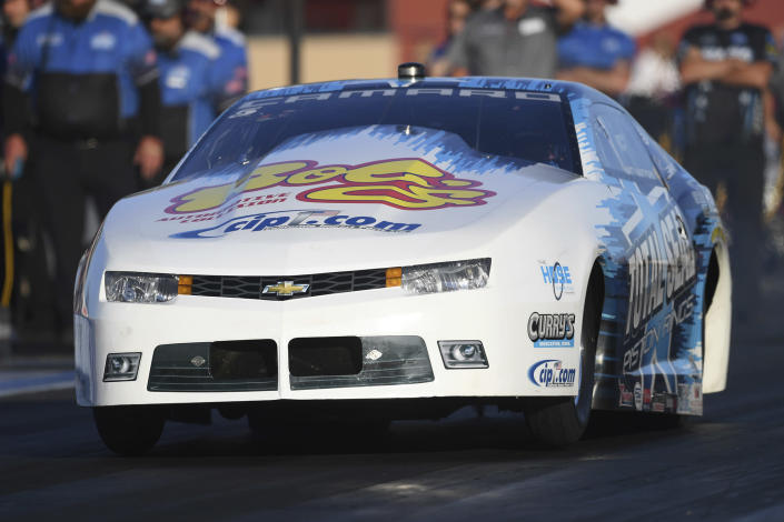 In this photo provided by the NHRA, Matt Hartford drives in Pro Stock qualifying Friday, July 23, 2021, at the NHRA Sonoma Nationals drag races in Sonoma, Calif. (Marc Gewertz/NHRA via AP)