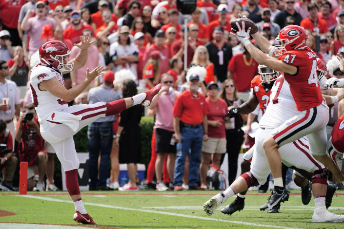Arkansas punter Reid Bauer (30) has his punt blocked by Georgia's Dan Jackson (47) during the first half of an NCAA college football game Saturday, Oct. 2, 2021, in Athens, Ga. Georgia recovered the ball in the end zone for a touchdown. (AP Photo/John Bazemore)